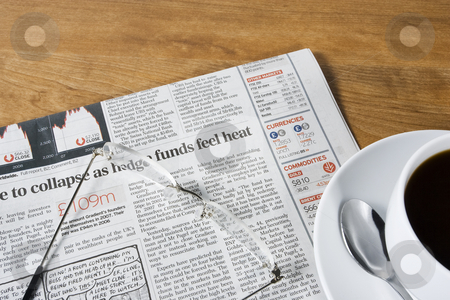 Coffee Break stock photo, A cup of black coffee together with a newspaper and reading glasses on a wood surface by Steve Smith