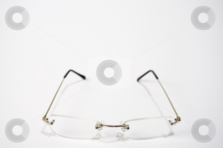 Reading Glasses stock photo, A pair of reading glasses facing front and center of a white frame by Steve Smith