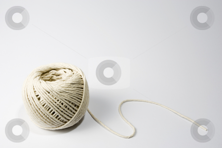Ball of string stock photo, A ball of string on the lower left-hand side of a white frame by Steve Smith