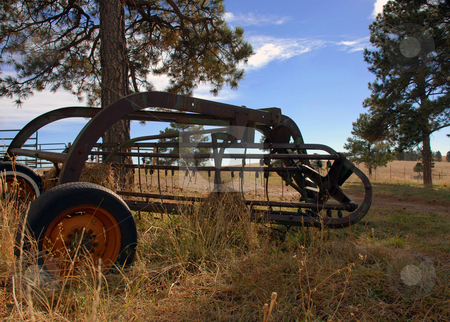 Tractor stock photo, Old Rusty Antique Tractor Sitting in a Field by Brian Shephard