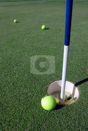 Golf Hole and ball stock photo,  by Brian Shephard