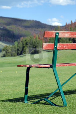 Bench at driving range stock photo,  by Brian Shephard