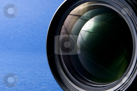 Lens Front Element stock photo, Front elements of a lens on the right-hand side of a blue background providing copy space by Steve Smith