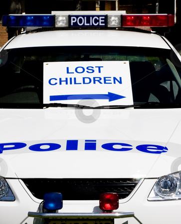Lost Children stock photo, A police car with lost children sign by Nicholas Rjabow