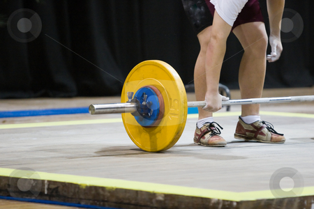 Weightlifting stock photo, A weightlifter holding the bar with one hand by Nicholas Rjabow