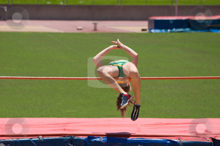 High Jump stock photo, An athlete competing in a high jump by Nicholas Rjabow