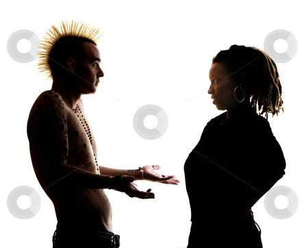 Man and woman looking at each other stock photo, Man with Mohawk and Woman wearing Dreadlocks by Scott Griessel