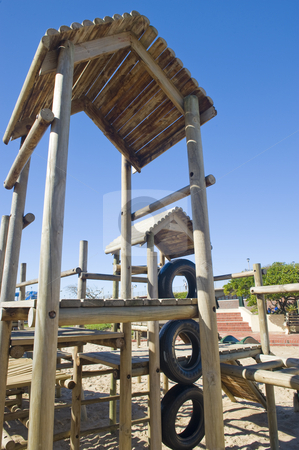 Park with jungle jim stock photo, A park next to the beach with a play area for kids containing a wooden jungle-jim. by Nicolaas Traut