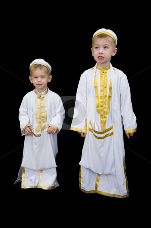 Cute boys with traditional Arabian dress stock photo, Cute little 3yr and 5yr old boys wearing traditional Arabian thobes for the purpose of asking for Ramadan treats. by Nicolaas Traut