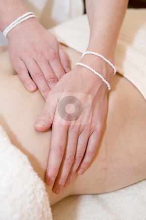 Attractive lady having therapy stock photo, An attractive mature lady undergoing aromatherapy and massaging. by Nicolaas Traut