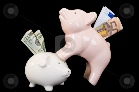 Piggybank with various currency stock photo, Piggybank with American Dollar and Euro banknotes on a black background. Concept of the Euro being on top of the Dollar, indicating the stronger currency. by Nicolaas Traut