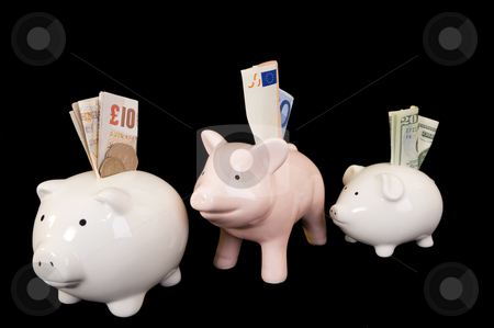 Piggybank with various currency stock photo, Piggybank with various international currencies on a black background. Conceptual shot showing Euro, Dollar and Sterling, indicating the weakness of the Dollar. by Nicolaas Traut