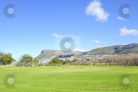 Golf driving range stock photo, A beautifully maintained practice or driving range with distance markers for golfers to practice on. by Nicolaas Traut