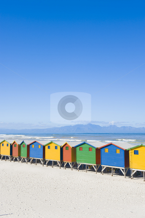 Colorful dressing huts on the beach stock photo, Brightly colored dressing huts on Muizenberg beach near Cape Town. by Nicolaas Traut