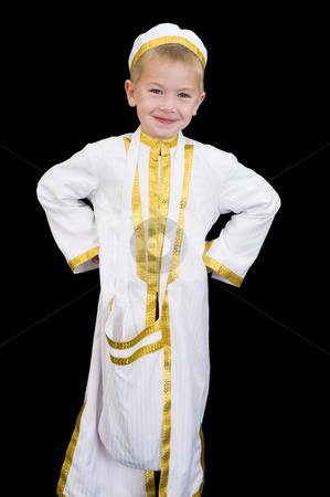Adorable kid with facial expression stock photo, An adorable little boy dressed in Arabian thobe, isolated on black. by Nicolaas Traut