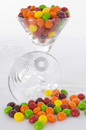 Candy cocktail stock photo, Colorful candy in a cocktail glass on a white background. by Nicolaas Traut