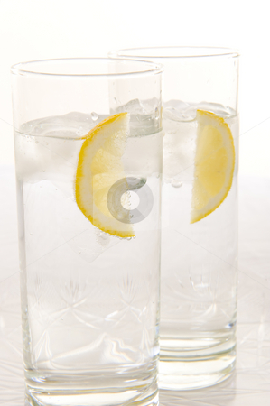 Water with fresh lemon stock photo, Sparkling water with slices of fresh lemon and lime on a white background. by Nicolaas Traut