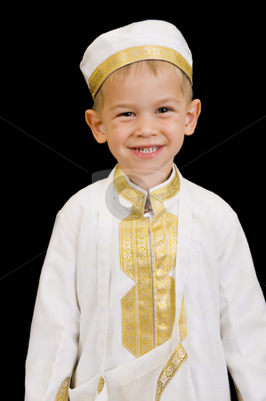 Cute boy with traditional Arabian dress stock photo, A cute little 3yr old boy wearing a traditional Arabian thobe for the purpose of asking for Ramadan treats. by Nicolaas Traut