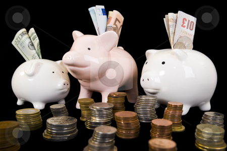 Piggybank with various currency stock photo, Piggybank with various international currencies on a black background. Three pigs are showing the 3 major international currencies, Dollar, Euro and Pound Stirling. Dollar is in the smaller pig conceptualizing the weak currency. by Nicolaas Traut