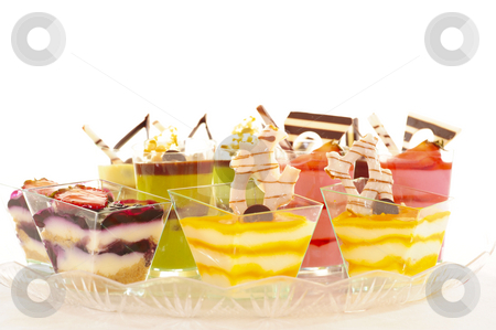 Assorted colorful desserts stock photo, An assortment of colorful mousse desserts in cups. by Nicolaas Traut