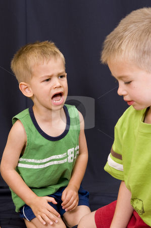 Little boy shouting at his brother stock photo, A cute little 3 year old boy shouting at his 5 year old brother. by Nicolaas Traut