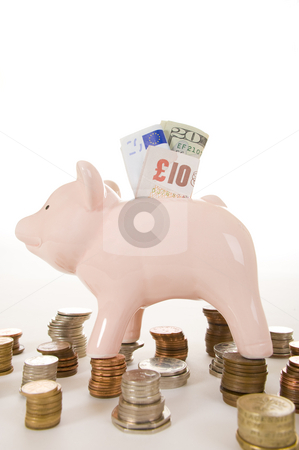 Piggybank with various currency stock photo, Piggybank with various countries currencies on white background, signifying the major currencies. Dollar, Euro and Pound Stirling is visible with coins from all over the world. by Nicolaas Traut