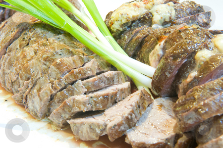 Fillet steak stock photo, Delicious sliced fillet steak of a Kudu, medium done and served on a plate. by Nicolaas Traut