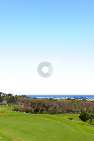 Clovelly golf course stock photo, The picturesque Clovelly golf course, nestled between mountains and with views of the town of Fish Hoek and the ocean. by Nicolaas Traut