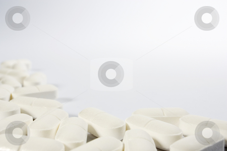 Pill Border stock photo, A border of pills on the left-hand side and lower part of a white frame by Steve Smith