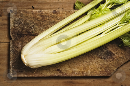 Celery Stalk on wooden kitchen table. stock photo, Celery Stalk on wooden kitchen table. by Pablo Caridad