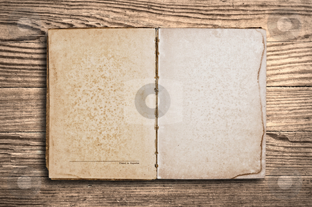 Vintage book over old wooden table. stock photo, Vintage book with blank pages over an old wooden table. by Pablo Caridad
