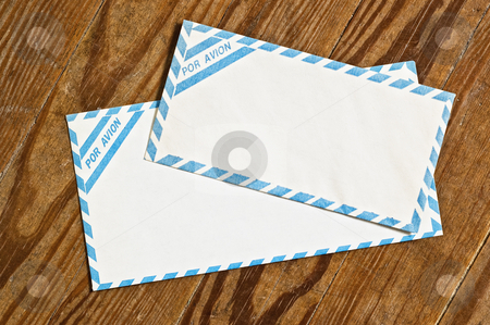 Old airmail envelopes over wood. stock photo, Old airmail envelopes over an old wooden table. by Pablo Caridad