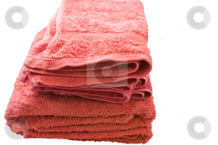 Bath Towels stock photo, A stack of red bath towels against a white background by Nicholas Rjabow
