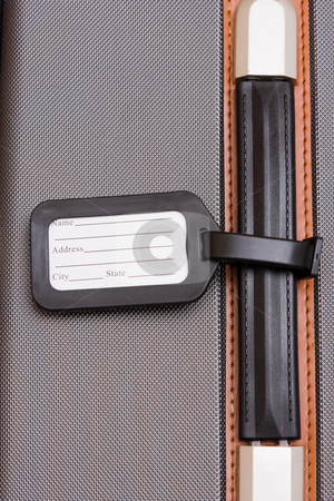 Black Luggage Tag On Baggage stock photo, A black luggage tag on a handle on a bag by Nicholas Rjabow