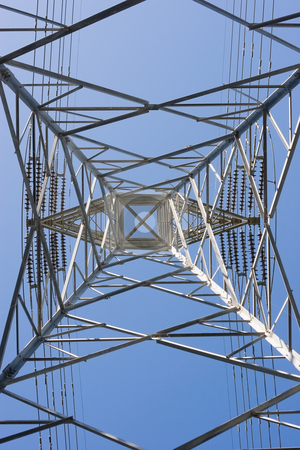 Electrical Pylon stock photo, Looking up an electricity pylon by Nicholas Rjabow