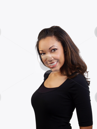 Young black woman smiling with braces on upper teeth stock photo, Smiling portrait of young black woman with braces on teeth by Jeff Cleveland