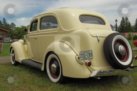 Old Ford 2-door sedan stock photo, This classic, 1936 Ford 2-door sedan has been restored to like new condition with a few extra flourishes.  The car was displayed at a summer car show in Minnesota. by Dennis Thomsen