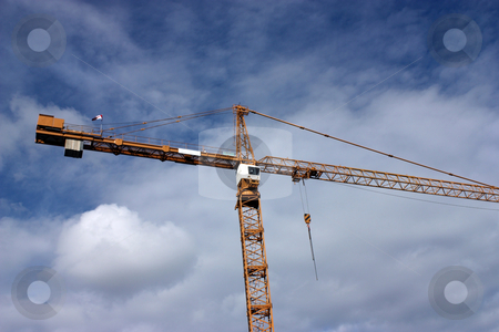 Construction Crane stock photo, Construction against a blue cloudy sky by Julie Bentz