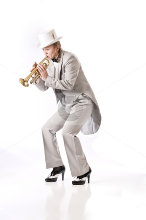 Bring it down gently stock photo, Pretty woman playing jazz on the trumpet by RCarner Photography