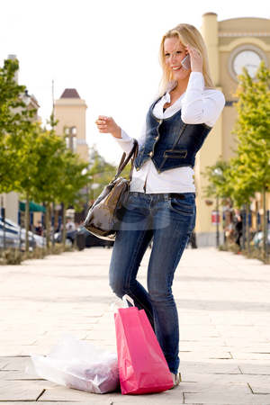 Blond girl calling stock photo, Beauty young girl shopping in the sunny weather by Frenk and Danielle Kaufmann