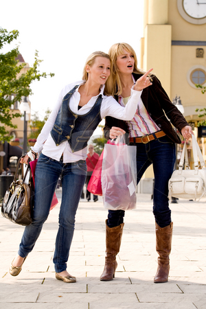 Watch there stock photo, Two young girls shopping in the sunny weather by Frenk and Danielle Kaufmann