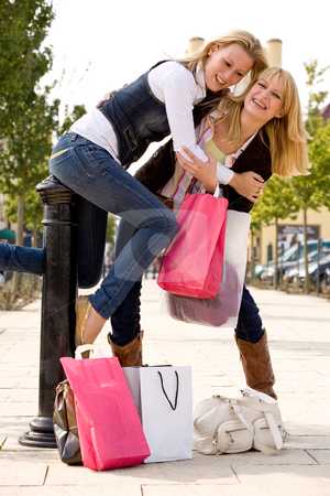 Falling from the pale stock photo, Two young girls shopping in the sunny weather by Frenk and Danielle Kaufmann