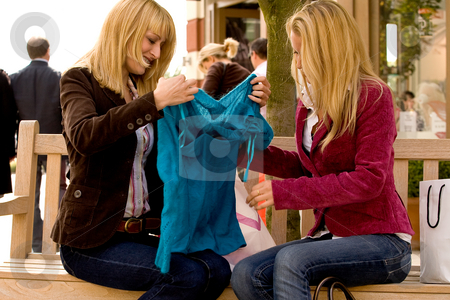 The new blue shirt stock photo, Two young girls shopping in the sunny weather by Frenk and Danielle Kaufmann