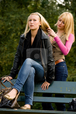 Sisters hairdo stock photo, Two sisters in a park having fun by Frenk and Danielle Kaufmann