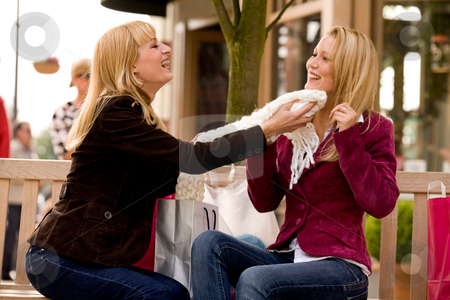 Feel the scarf stock photo, Two young girls shopping in the sunny weather by Frenk and Danielle Kaufmann