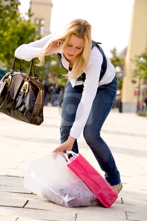 Bending blond woman stock photo, Beauty young girl shopping in the sunny weather by Frenk and Danielle Kaufmann