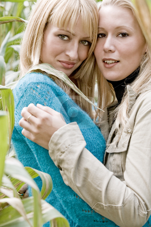 2 sisters in a cornfield stock photo, Two sisters in a park having fun by Frenk and Danielle Kaufmann