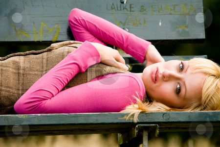 On my back on a bench stock photo, Beautifull young girl relaxing in a park by Frenk and Danielle Kaufmann
