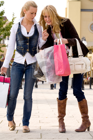 Check our bags stock photo, Two young girls shopping in the sunny weather by Frenk and Danielle Kaufmann