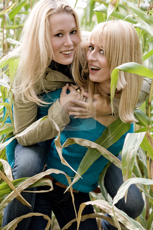 Bunnyhop in a cornfield stock photo, Two sisters in a park having fun by Frenk and Danielle Kaufmann